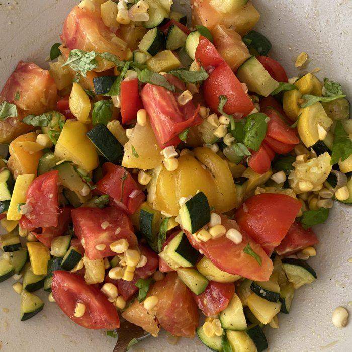 Corn zucchini and tomato salad
