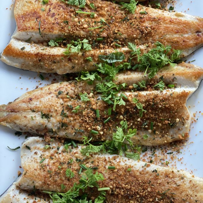 Grilled fish with crunchy breadcrumbs and fresh herbs