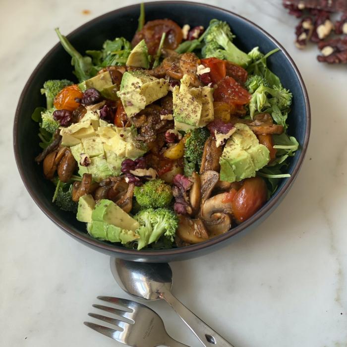 Warm tomato and mushroom arugula salad