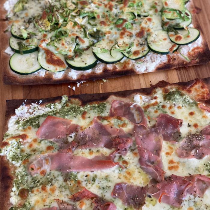 Flat bread pizzas: veggies loaded and prosciutto ricotta